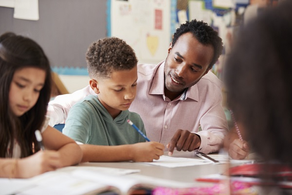 The educational assistant helps provide children with more individual support